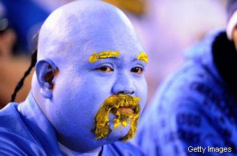 If Guy Fieri shaved his head and auditioned for the Blue Man Group.