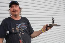 We're having this guy go door to door with the trophies.