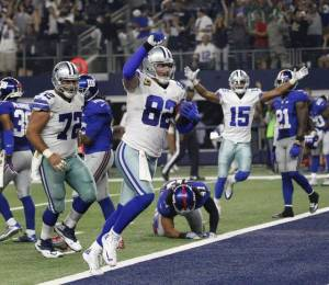 Witten celebrating the go ahead touchdown, and a quieter Dez Bryant free huddle